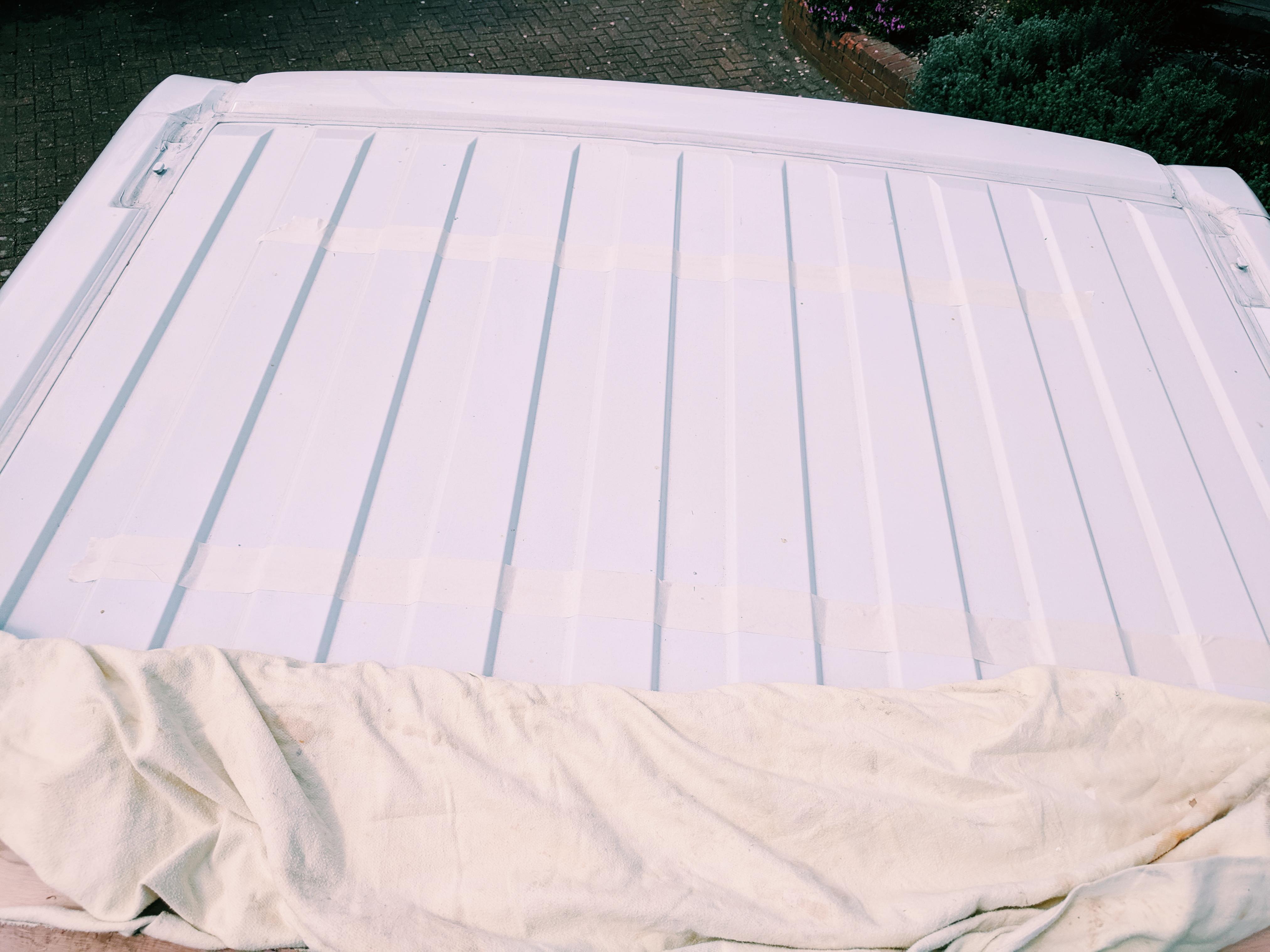 marking out heki midi rooflight with masking tape